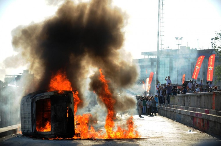 A police car burns, set alite on Taksim square in Istanbul on June 3, 2013 during protests against the Islamic-rooted government. (Bulent Kilic/AFP/Getty Images)