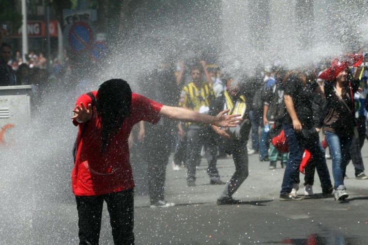 A protestor receives water cannon during clashes at a demonstration in Ankara on June 3, 2013 after days of protests against the Islamic-rooted government. (Adem Altan/AFP/Getty Images)