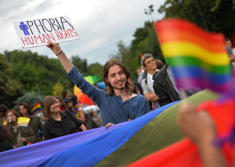 "A demonstrator holds up a sign reading ""Phobia- Human Rights"" during in a Gay Pride demonstration, on June 8, 2013 in Bucharest. Some 400 people took to the streets of Bucharest for a Gay Pride parade overshadowed by a controversial amendment to the Romanian constitution banning same-sex marriage. (Daniel Mihailescu/AFP/Getty Images)"
