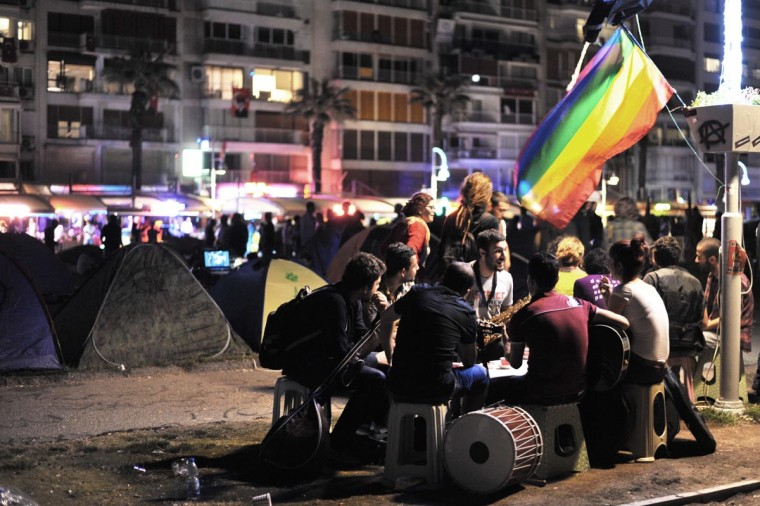 Anti-government musicians sit together after the demonstration on June 9, 2013 on Gundogdu square in Izmir in Turkey. (Ozan Kose/AFP/Getty Images)