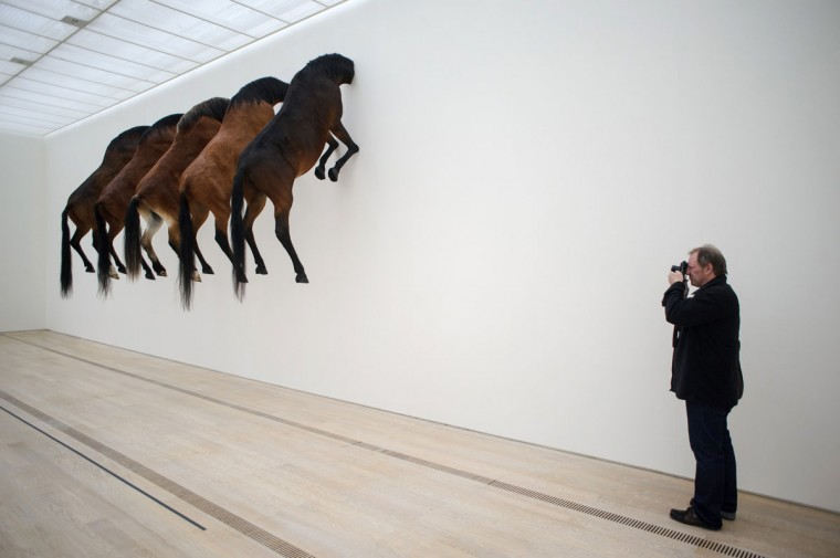 A photograph shoots an art project by Italian artist Maurizio Cattelan at the Beyeler Foundation in Basel on June 10, 2013 during a press day for the Art Basel 2013 international art show. (Sebastien Bozon/AFP/Getty Images)