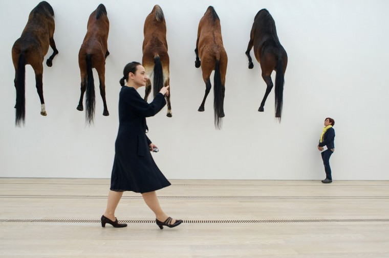 A woman walks past an art project by Italian artist Maurizio Cattelan at the Beyeler Foundation in Basel on June 10, 2013 during a press day for the Art Basel 2013 international art show. (Sebastien Bozon/AFP/Getty Images)