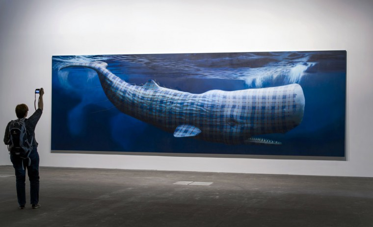 "A visitor snaps a picture on June 10, 2013 of Sean Landers' artwork entitled ""Moby Dick (Merrilees)"" during the preview day of Art Basel. (Fabrice Coffrini/AFP/Getty Images)"