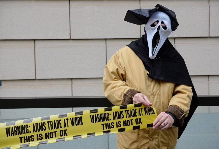 A demonstrator from 'Stop G8' is pictured outside the offices of BAE Systems in London on June 12, 2013, during a protest against the G8 Summit. (Leon Neal/AFP/Getty Images)