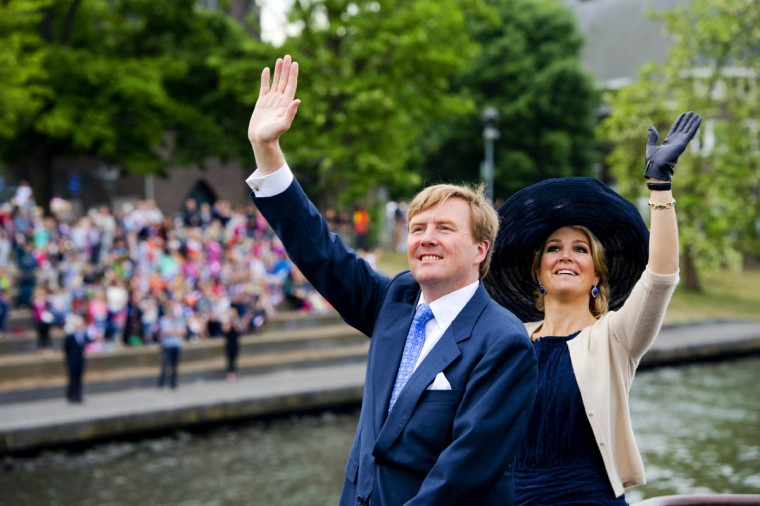 The Netherlands' King Willem-Alexander (Left) and Queen Maxima wave to onlookers during their visit to Maastricht, in the Limburg region of The Netherlands. The Royal couple visit all the 12 Dutch provinces to give people a chance to meet the new King and Queen. (Robin Utrecht /Getty Images)