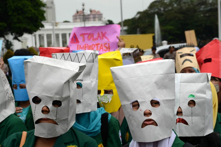 Indonesian students wear masks with angry expressions during a protest outside the presidential palace in Jakarta to denounce impending fuel price increases, as the government plans to reduce a fuel subsidy. Indonesian President Susilo Bambang Yudhoyono said on April 30 that he hopes to lower fuel subsidies which are a risk to Southeast Asia's top economy as concern mounts over the economic damage wrought by the scheme that gobbles up more than 16 percent of the state budget. (Romeo Gacad/Getty Images)