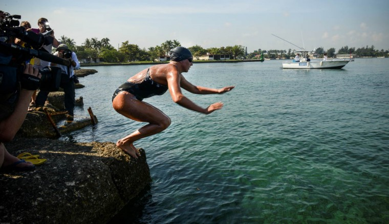 Australian swimmer Chloe McCardel dives from Marina Hemingway in Havana. McCardel will attempt to become the first to cross the Florida Straits swimming through the shark-infested sea without a protective cage. (Adalberto Roque/Getty Images)
