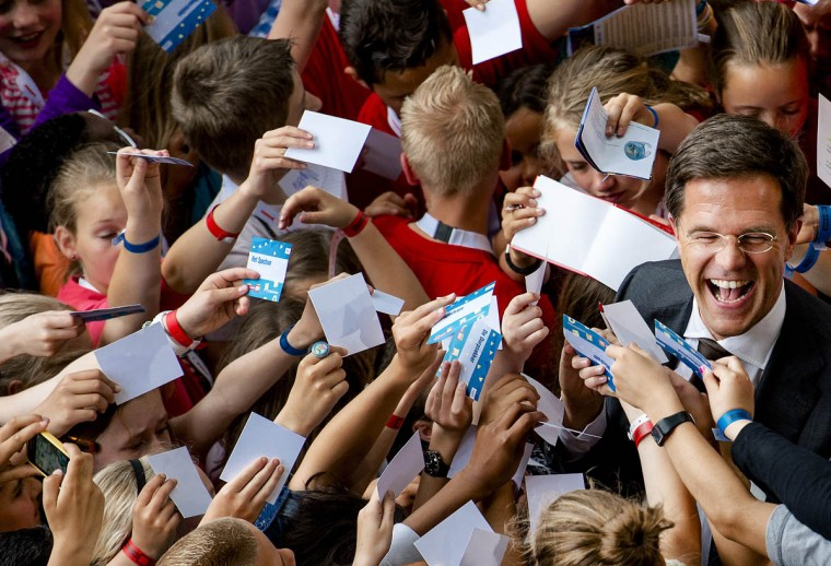 Dutch prime minister Mark Rutte is surrounded by children asking for autographs, after a press conference he gave to children on the Day of the Children's Journal in Hilversum. (Robin Van Lonkhuijsen/Getty Images)