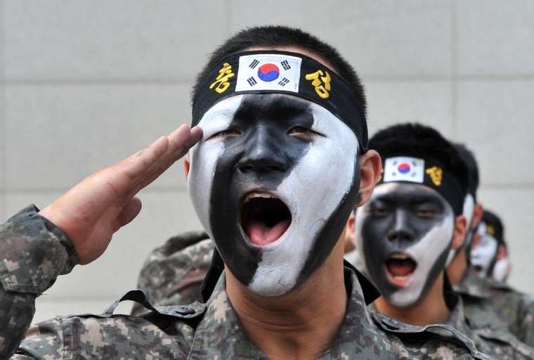 South Korean soldiers perform martial arts before an anti-terror drill as part of preparations for the 4th Asian Indoor and Martial Arts Games at a gymnasium in Incheon, west of Seoul, on June 13, 2013. Incheon is hosting the tournament for minority sports such as billiards, dance sports and kickboxing this summer as part of preparations for the 2014 Asian Games. (Jung Yeon-JeJung/AFP/Getty Images)