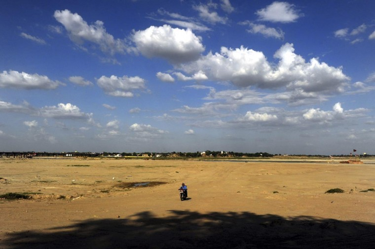 Cumulus clouds are pictured in the sky near the River Ganges in Allahabad on June 13, 2013. The weather department has forecast India will receive normal rains this year, raising prospects of a stronger performance by Asia's third-largest economy. (Sanjay Kanojia/AFP/Getty Images)