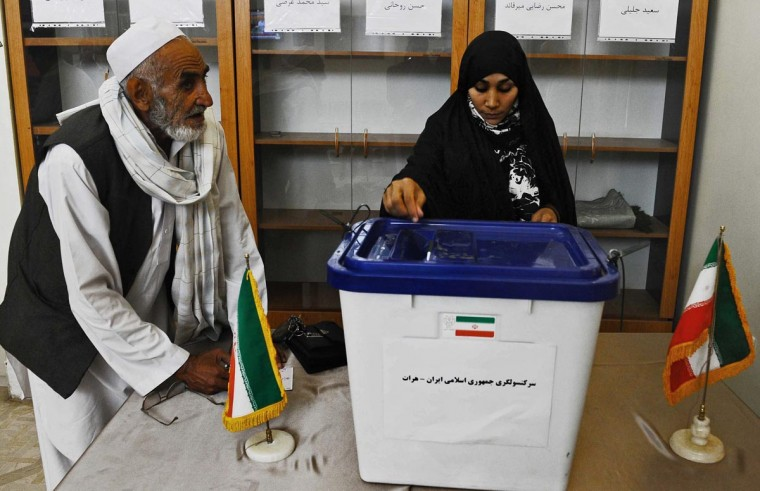 An Iranian citizen casts her ballot to elect a new Iranian president at the Iranian consulate in Herat on June 14, 2013. (Aref Karimi/AFP/Getty Images)