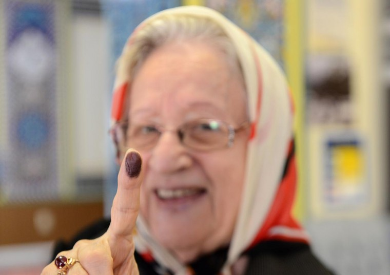 An Iranian citizen shows her finger covered in ink after voting in the Iranian presidential election at a polling station set up inside the Manassas Masjid mosque in Manassas, Virginia June 14, 2013. Iranian-Americans and expatriates in the Washington area streamed to polling stations Friday to have a say in their homeland's presidential election. (Sasan Afsoosi/AFP/Getty Images)