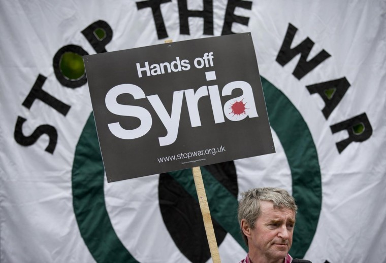 A man holds a placard during a demonstration against Western involvement in the Syria conflict outside the US embassy in London on June 15, 2013 ahead of the G8 Summit. (Justin Tallis/AFP/Getty Images)