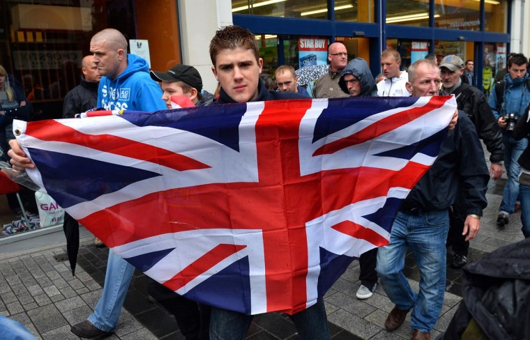 A man holds a Union flag in the city center in Belfast, Northern Ireland, on June 15, 2013 during a planned Trade Unions rally ahead of the G8 Summit. Many protetsers carried anti-G8 placards during the event which was met at it's culmination with a Loyalist flag protest. (Justin Tallis/AFP/Getty Images)