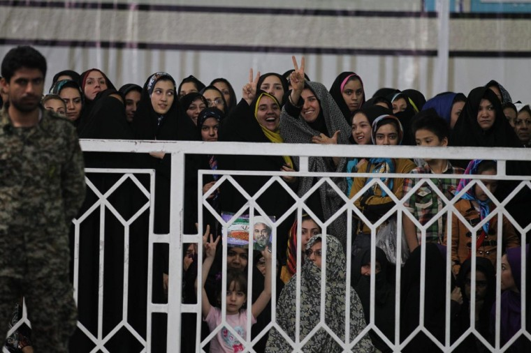 Iranian supporters of President-elect Hassan Rowhani gather at the mausoleum of the founder of Iran's Islamic Republic Ayatollah Ruhollah Khomeini, in Tehran on June 16, 2013, during a visit of Rowhani at the mausoleum. (Atta Kenare/AFP/Getty Images)