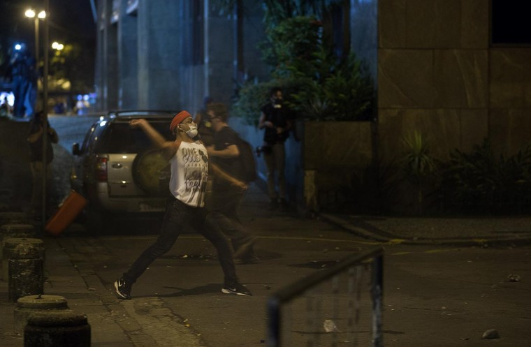 A youngster throws a stone during a protest in Rio de Janeiro, Brazil on June 17, 2013. (Christophe Simon/AFP/Getty Images)