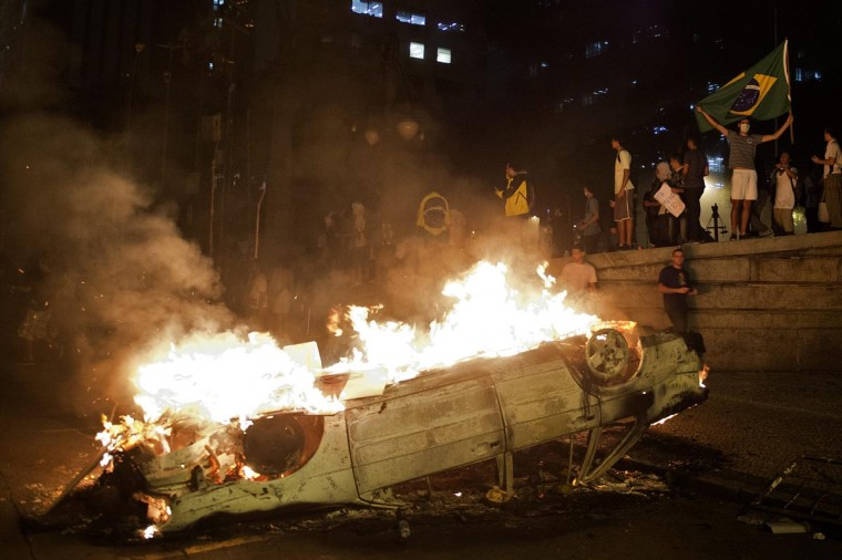A burning car is seen in front of the Congress State during a demonstration in Rio de Janeiro, Brazil on June 17, 2013. (Pablo Porcuincula/AFP/Getty Images)