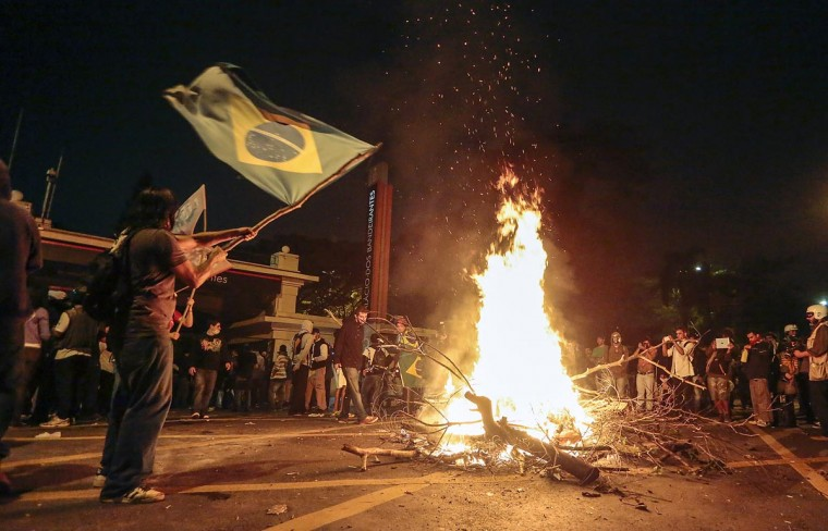 Students light a bonfire during a protest in fron of the Government Palace, in Sao Paulo, Brazil on June 17, 2013. (Miguel Schincariol/AFP/Getty Images)