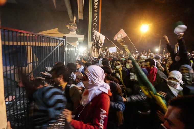 Students attempt to enter the Government Palace, in Sao Paulo, Brazil on June 17, 2013. (Miguel Schincariol/AFP/Getty Images)