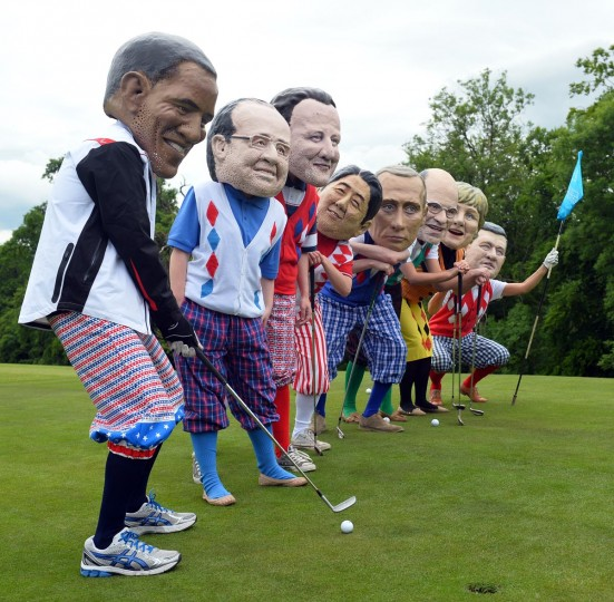 Protesters from anti-hunger charity Oxfam wearing masks depicting the leaders of the G8 countries pose on a golf course in Enniskillen in Northern Ireland on June 18, 2013 near the venue of the G8 summit at the golfing resort of Lough Erne. (Paul Ellis/AFP/Getty Images)