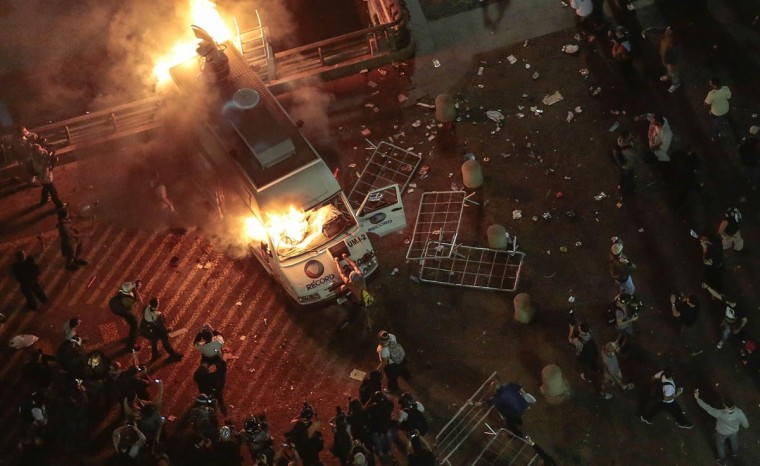 A vandalized press car from TV Record burns during a student demonstration in front of the City Hall in Sao Paulo, Brazil on June 18, 2013, against a recent rise in public bus and subway fare from 3 to 3.20 reais (1.50 USD). (Miguel Schincariol/AFP/Getty Images)