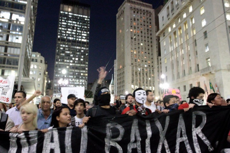 Students protest in Sao Paulo, Brazil on June 18, 2013, against a recent rise in public bus and subway fare from 3 to 3.20 reais (1.50 USD). (Daniel Guimaraes/AFP/Getty Images)