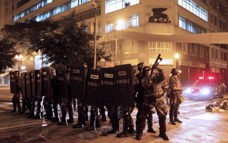 Riot polce take positions during a protest in Sao Paulo, Brazil on June 18, 2013 against a recent rise in public bus and subway fare from 3 to 3.20 reais (1.50 USD). (Daniel Guimaraens/AFP/Getty Images)