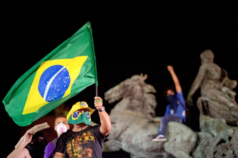 A demonstrator waves the Brazilian flag late on June 19, 2013 during clashes in the center of Niteroi, 10 kms from Rio de Janeiro. (Christophe Simon/AFP/Getty Images)