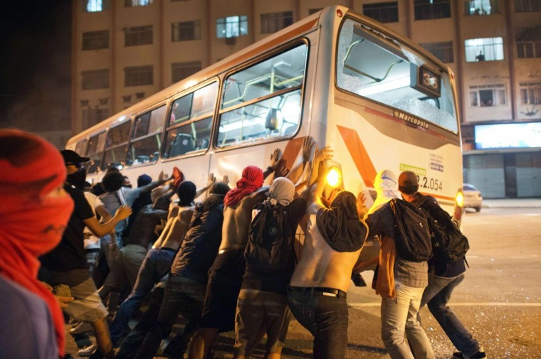 Demonstrators overturn a bus late on June 19, 2013 in the center of Niteroi, 10 kms from Rio de Janeiro. (Christophe Simon/AFP/Getty Images)