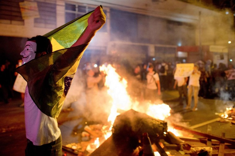 A demonstrator holds a flag late on June 19, 2013 during clashes in the center of Niteroi, 10 kms from Rio de Janeiro. (Christophe Simon/AFP/Getty Images)