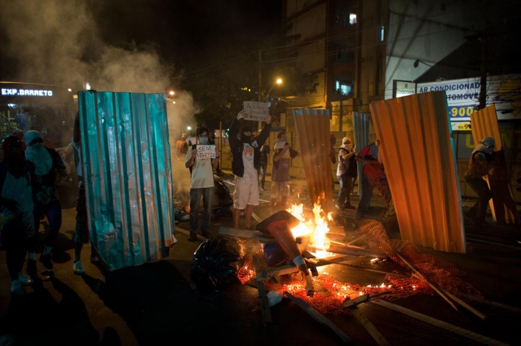 Demonstrators build a barricade late on June 19, 2013 during clashes in the center of Niteroi, 10 kms from Rio de Janeiro. (Christophe Simon/AFP/Getty Images)