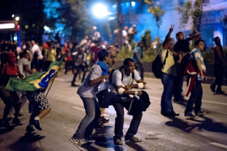 Protestors face the police on June 19, 2013 during clashes in the center of Niteroi, 10 kms from Rio de Janeiro. (Christophe Simon/AFP/Getty Images)
