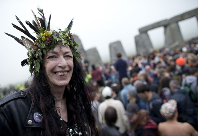 Revelers celebrate the pagan festival of 'Summer Solstice' at Stonehenge in southern England, on June 21, 2013. The festival, which dates back thousands of years, celebrates the longest day of the year when the sun is at its maximum elevation. Modern druids and people gather at the landmark Stonehenge every year to see the sun rise on the first morning of summer. (Justin Tallis/AFP/Getty Images)