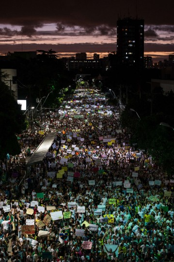 Thousands of people march in the center of Recife, state of Pernambuco, Brazil, on June 20, 2013, during a protest of what is now called the 'Tropical Spring' against corruption and price hikes. Brazilians took to the streets again on a new day of mass nationwide protests, demanding better public services and bemoaning massive spending to stage the World Cup. More than one million people have pledged via social media networks to march in 80 cities across Brazil, as the two-week-old protest movement -- the biggest seen in the South American country in 20 years -- showed no sign of abating. (Yasuyoshi Chiba/AFP/Getty Images)