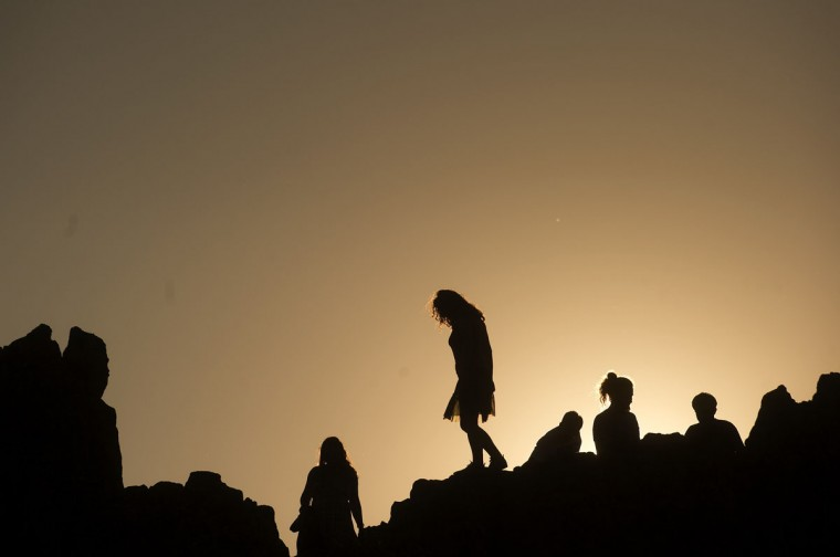 People look at the horizon soon after sunrise from the rocky crest filled with astronomical markers at the megalithic observatory of Kokino during the summer solstice. (Robert Atanasovski/AFP/Getty Images)