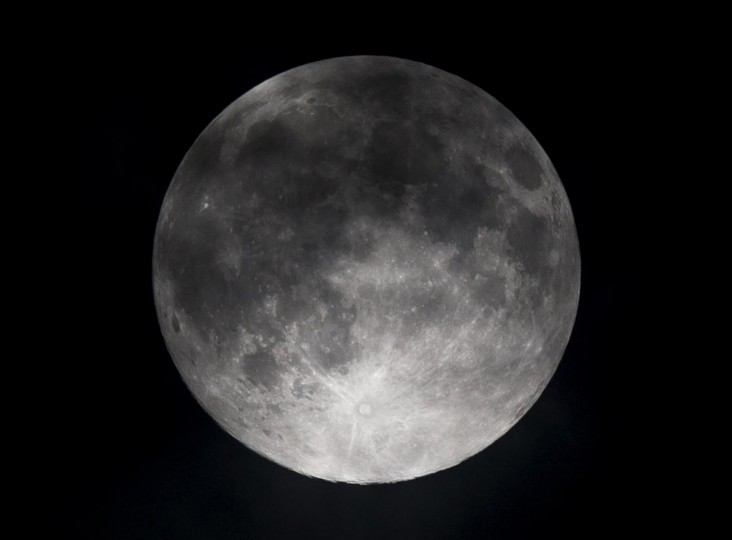 A picture taken on June 23, 2013 shows a full moon over Mexico city. This year the supermoon is up to 13.5 percent larger and 30 percent brighter than a typical full moon is, according to NASA scientists. (Ronaldo Schemidt/AFP/Getty Images)