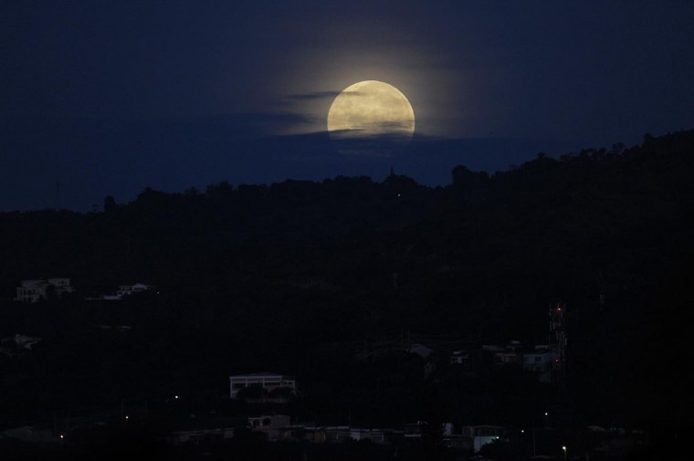 A picture taken on June 23, 2013 shows a full moon over San Salvador, El Salvador. This year the supermoon is up to 13.5 percent larger and 30 percent brighter than a typical full moon is, according to NASA scientists. (Jose Cabezas/AFP/Getty Images)
