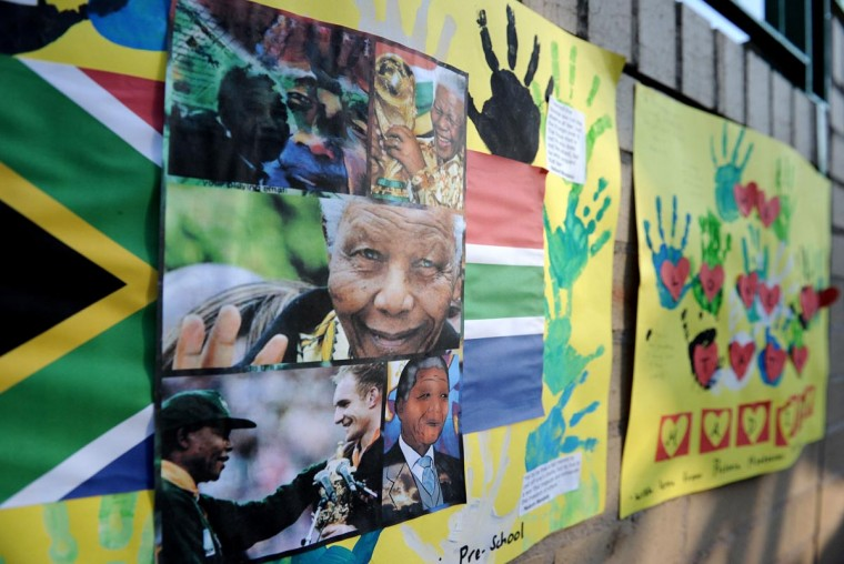 Art work by pre-school children wishing former South African President Nelson Mandela (on poster) well are displayed at the entrance of the Medi-Clinic Heart Hospital on June 24, 2013 in Pretoria, where Mandela is staying. (Stephane de Sakutin/AFP/Getty Images)