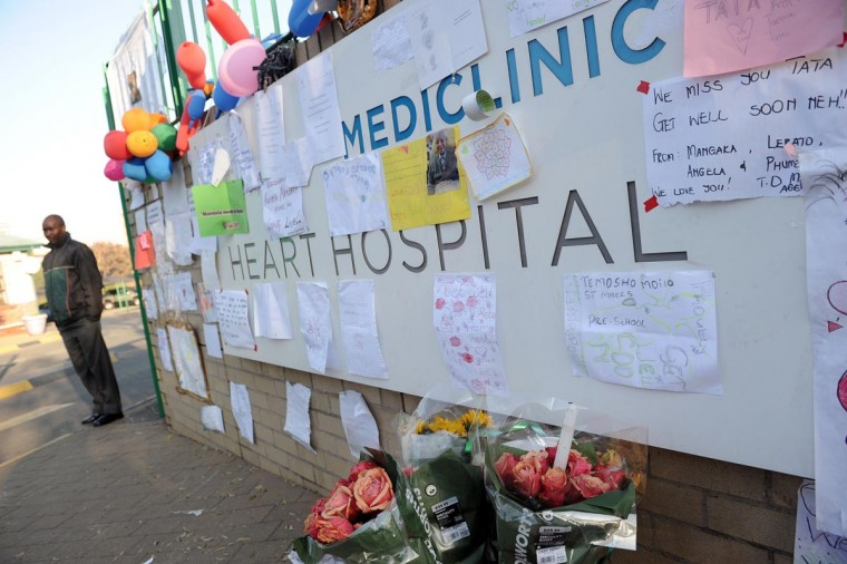 Balloons and letters wishing former South African President Nelson Mandela well are displayed at the entrance of the Medi-Clinic Heart Hospital on June 24, 2013 in Pretoria, where Mandela is staying. (Stephane de Sakutin/AFP/Getty Images)
