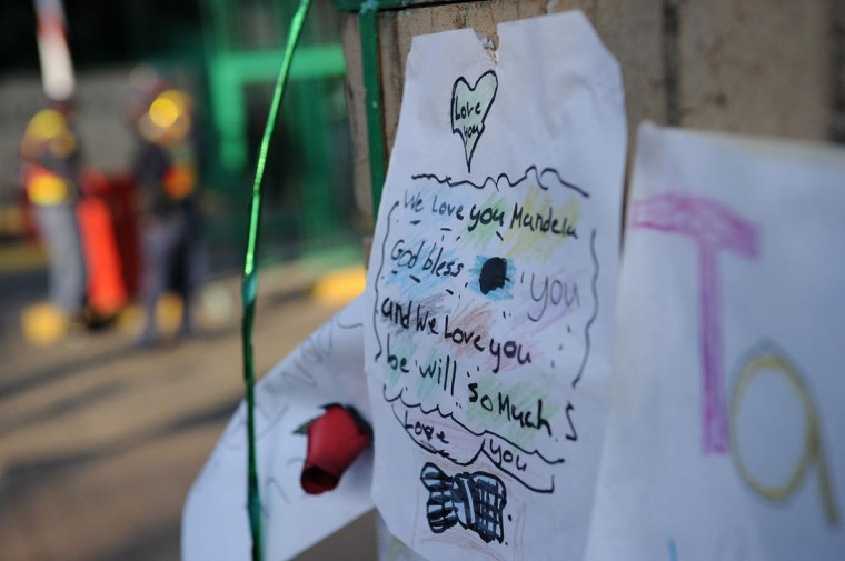 A letter wishing former South African President Nelson Mandela well is displayed at the entrance of the Medi-Clinic Heart Hospital on June 24, 2013 in Pretoria, where Mandela is staying. (Stephane de Sakutin/AFP/Getty Images)