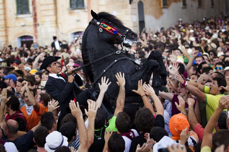 A horse rears in a crowd during a horse parade of the traditional San Juan (Saint John) festival in the town of Ciutadella, on the Balearic Island of Menorca on June 23, 2013, on the eve of Saint John's day. (Jaime Reina/AFP/Getty Images)