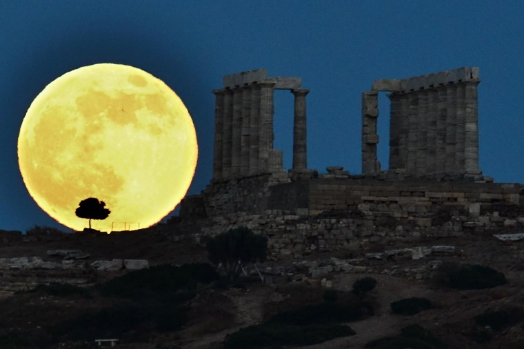A supermoon rises next to the ancient Greek temple of Poseidon at Cape Sounion, some 65 kilometers south of Athens, on June 23, 2013. (Aris Messinis/AFP/Getty Images)