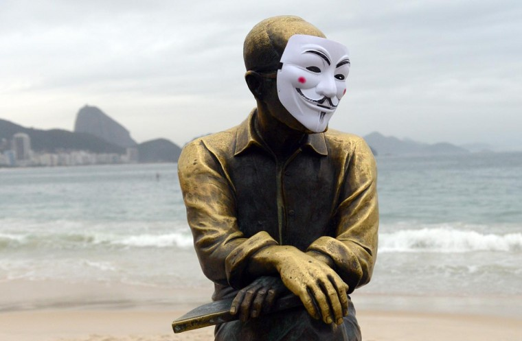 The statue of Brazilian poet Carlos Drummond de Andrade on Copacabana beach is decorated with a Guy Fawkes mask during a protest for better public services in Rio de Janeiro on June 23, 2013. The protests come as Brazil hosts a dry run for the World Cup, called the Confederations Cup. (Yasuyoshi Chiba/AFP/Getty Images)