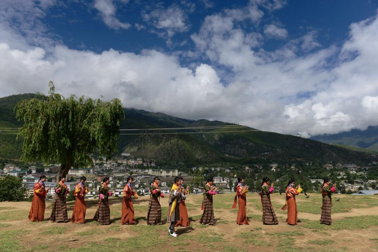 Bhutanese school teenagers practice before a cultural event to celebrate the birth date of Bhutan's fourth king in Thimphu on June 2, 2013. (Roberto Schmidt/AFP/Getty Images)