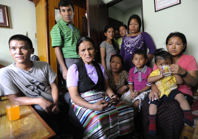 Doma Sherpa (R), the wife of Nepalese climber Sona Sherpa, who was killed by Taliban militants at Nanga Parbat base camp in Pakistan, holds her children at their home in Kathmandu on June 24, 2013. Pakistan suspended expeditions to its second-highest peak, evacuating climbers from Nanga Parbat after 10 foreign tourists were shot dead by Islamist gunmen at the base camp. (Prakash Mathe/AFP/Getty Images)
