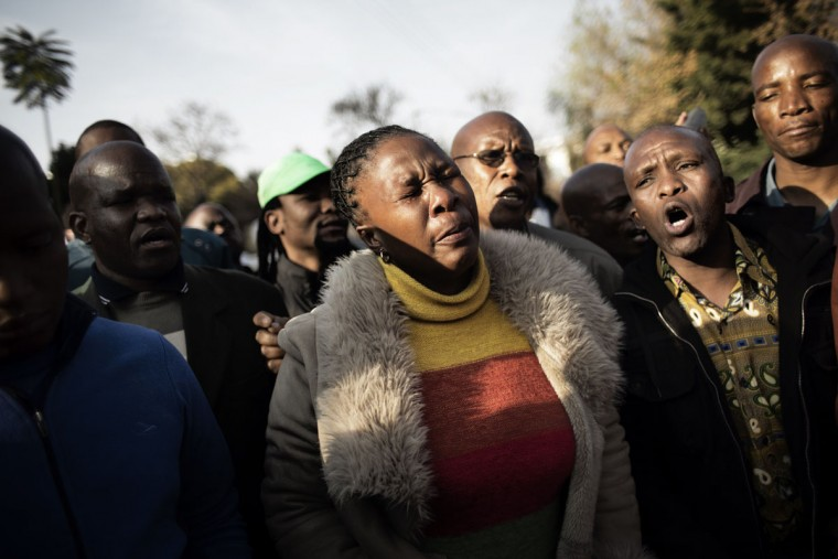 A woman cries while praying with other residents of the mining region of Marikana in South Africa outside the Mediclinic Heart Hospital, where former South African President Nelson Mandela is hospitalized in Pretoria on June 29, 2013. Mandela, who turns 95 next month, has been in intensive care for three weeks for a recurrent lung disease dating from his years in apartheid-era prisons. (Marco Longari/AFP/Getty Images)
