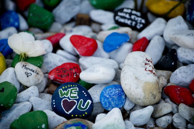 Pebble stones with get well messages for former South African President Nelson Mandela are seen outside his home in Johannesburg on June 29, 2013. U.S. President Barack Obama met the family of his critically ill hero Mandela on a visit to South Africa, the White House said.The president, whose landmark trip to Africa has been overshadowed by Mandela's illness, decided not to visit the ailing icon, instead meeting family members at the Mandela Centre of Memory in Johannesburg. (Odd Andersen/AFP/Getty Images)