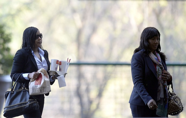 "Former South African President Nelson Mandela's daughter Makaziwe (right), and grandaughter Indileka, arrive at the Medi Clinic Heart hospital in Pretoria on June 29, 2013. U.S. President Barack Obama met the family of his ""inspiration"" Nelson Mandela but was unable to visit the anti-apartheid legend who remains critically ill in hospital.(Filippo Monteforte/AFP/Getty Images)"