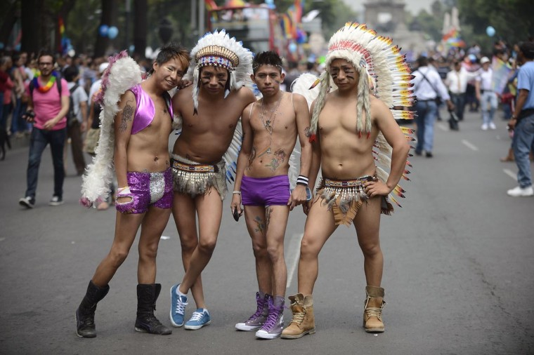 People march during the 35th Gay Pride Parade along Reforma Avenue in Mexico City on June 29, 2013. (Alfredo Estrella/AFP/Getty Images)