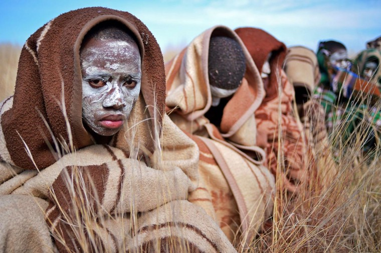 Boys from the Xhosa tribe who have undergone a circumcision ceremony sit near Qunu on June 30, 2013. (Carl De Souza/AFP/Getty Images)